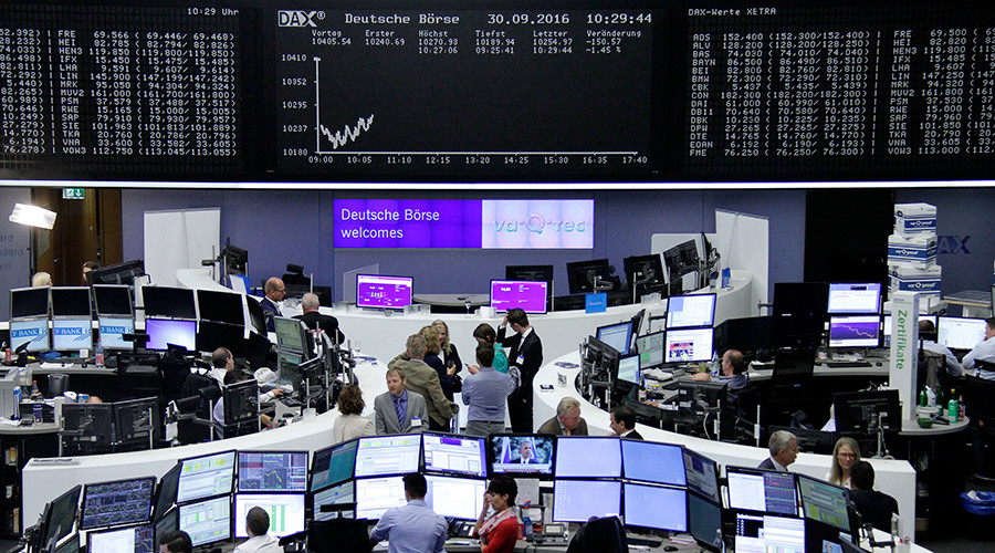 Traders work at their desks in front of the German share price index, DAX board, at the stock exchange in Frankfurt, Germany, September 30, 2016 © Remote