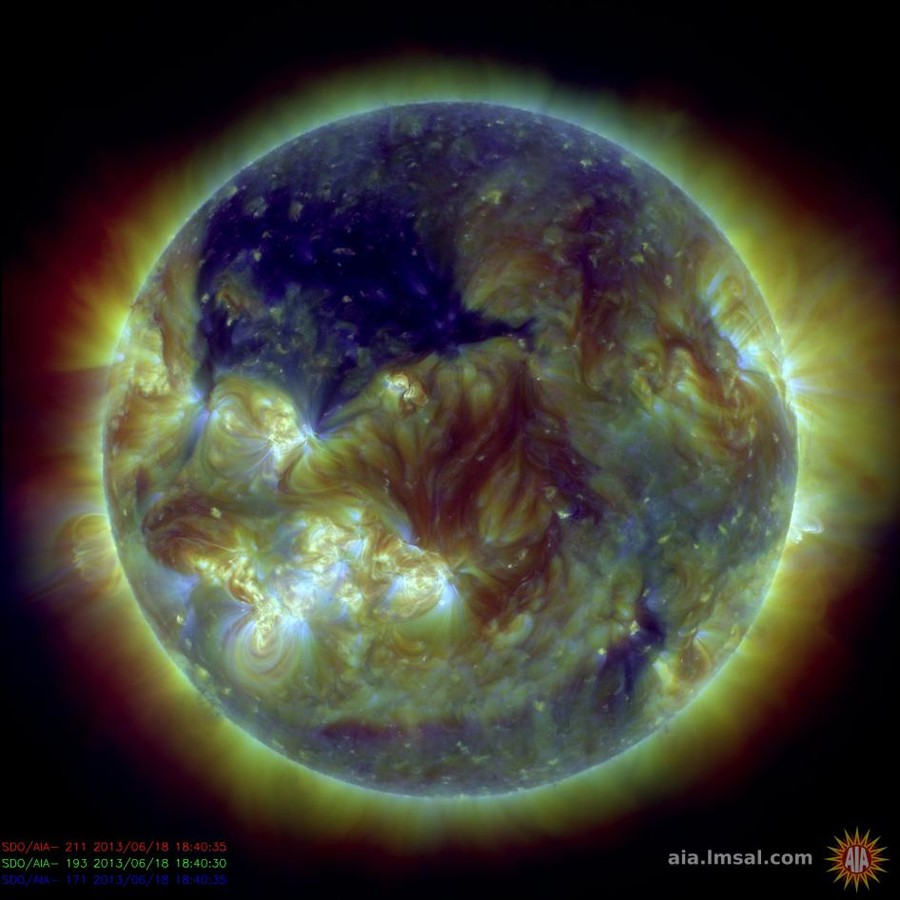 © NASA's Solar Dynamics Observatory captured this picture of the sun on June 18, 2013, showing a huge coronal hole – seen here in dark blue