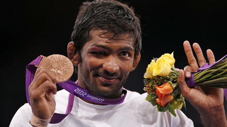 India's Yogeshwar Dutt poses with his bronze medalat the podium of the Men's 60Kg Freestyle wrestling at the ExCel venue during the London 2012 Olympic Games © Suhaib Salem