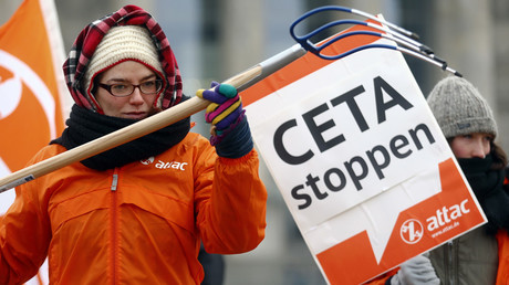 An activists from the anti-globalisation organisation ATTAC at the protest against planned trade pact CETA (Comprehensive Economic and Trade Agreement) with Canada, in Berlin © Hannibal Hanschke