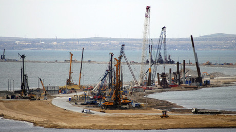 The construction of a bridge across the Kerch Strait to Crimea is seen from the outskirts of the Taman settlement in Krasnodar region, southern Russia. © Andrew Osborn