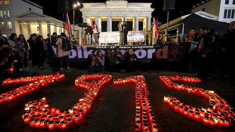 FILE PHOTO: The year 1915 is formed with candles during a memorial march by Armenians in front of the Brandenburg Gate © Fabrizio Bensch