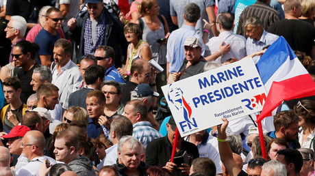 Supporters of Marine Le Pen, French National Front (FN) political party leader and Member of the European Parliament, attend a FN political rally in Brachay, France, September 3, 2016. © Gonzalo Fuentes