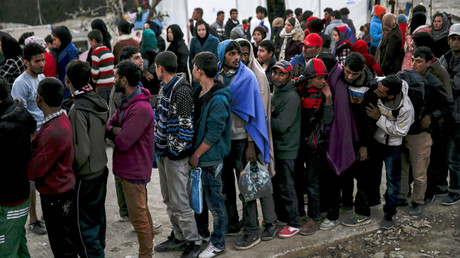 Refugees and migrants line up for a food distribution at the Moria refugee camp on the Greek island of Lesbos. File photo. © Alkis Konstantinidis