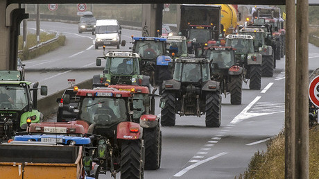 Truck drivers and farmers drive from Loon Plage to Calais, on September 5, 2016, during a joint