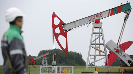 A worker at a pump jack at an oil field owned by Bashneft company north from Ufa, Russia. ©Sergei Karpukhin