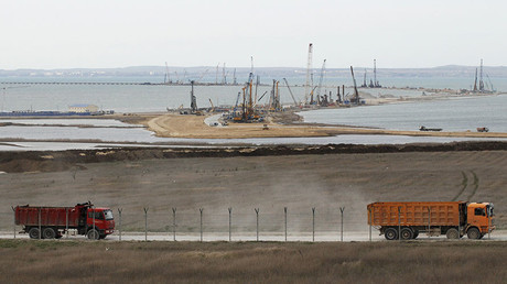 The construction of a bridge across the Kerch Strait to Crimea is seen from the outskirts of the Taman settlement in Krasnodar region, southern Russia © Andrew Osborn