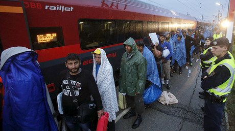 Migrants arrive at the Austrian train station of Nickelsdorf. © Heinz-Peter Bader