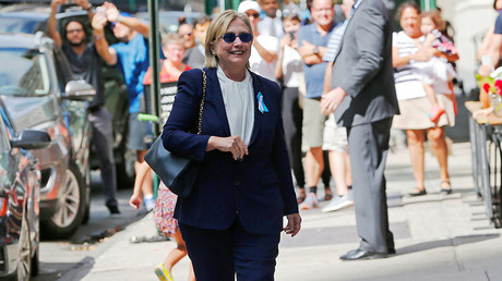 "U.S. Democratic presidential candidate Hillary Clinton leaves her daughter Chelsea's home in New York, New York, United States September 11, 2016, after Clinton left ceremonies commemorating the 15th anniversary of the September 11 attacks feeling ""overheated."" © Brian Snyder"