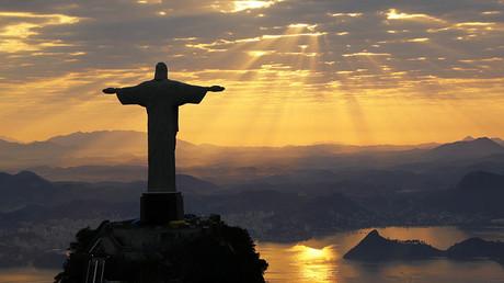 Christ The Redeemer is seen during sunrise in Rio de Janeiro, Brazil ©Wolfgang Rattay