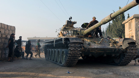 Rebel fighters ride a tank in an artillery academy of Aleppo, Syria © Ammar Abdullah