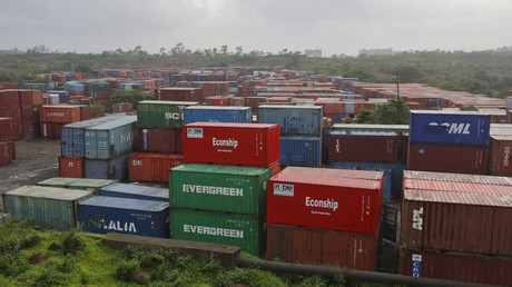 Cargo containers are seen stacked outside the container terminal of Jawaharlal Nehru Port Trust (JNPT) in Mumbai, India © Shailesh Andrade