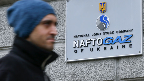 A man walks past the headquarters of the Ukrainian national joint stock company NaftoGaz in central Kiev, Ukraine. © Valentyn Ogirenko