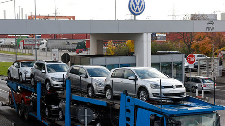 A truck, loaded with Volkswagen cars, leaves the truck gate