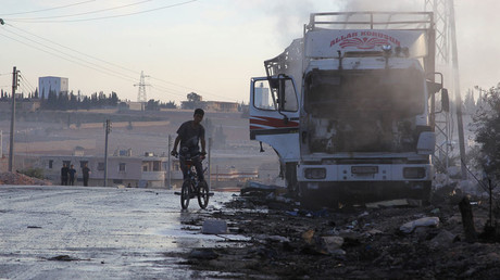 A boy rides a bicycle near a damaged aid truck, western Aleppo city, Syria September 20, 2016. © Ammar Abdullah