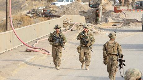 U.S soldiers walk on a bridge with in the town of Gwer northern Iraq © Azad Lashkari