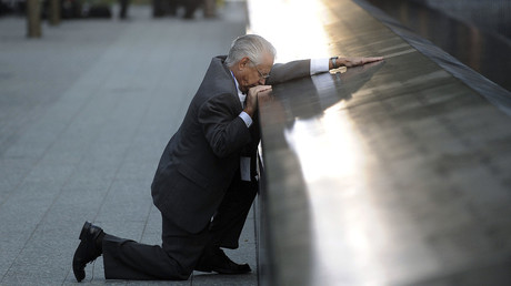 Robert Peraza, who lost his son Robert David Peraza, pauses at his son's name at the North Pool of the 9/11 Memorial during tenth anniversary ceremonies at the site of the World Trade Center in New York, September 11, 2011. © Justin Lane