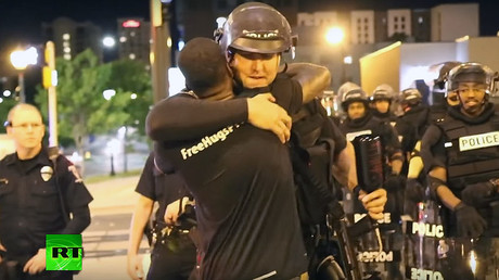 'We're all human': Charlotte activist hugs riot police (VIDEO)