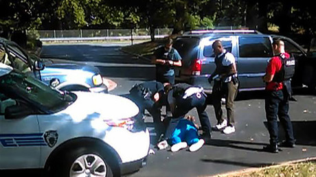 This video frame grab obtained September 23, 2016,taken by Rakeyia Scott, courtesy of Curry Law Firm, shows the moments after the shooting of Keith Lamont Scott in Charlotte, North Carolina. © Rakeyia Scott