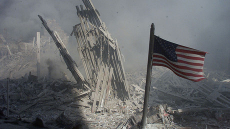 Am American flag flies near the base of the destroyed World Trade
