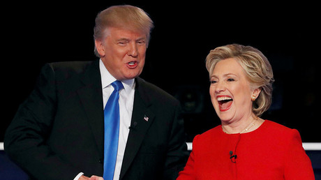 Republican U.S. presidential nominee Donald Trump shakes hands with Democratic U.S. presidential nominee Hillary Clinton at the conclusion of their first presidential debate at Hofstra University in Hempstead, New York, U.S., September 26, 2016. © Mike Segar