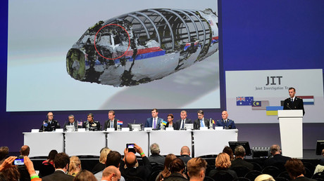 Members of a joint investigation team present the preliminary results of the criminal investigation into the downing of Malaysia Airlines flight MH17 , in Nieuwegein, on September 28, 2016.© Emmanuel Dunand