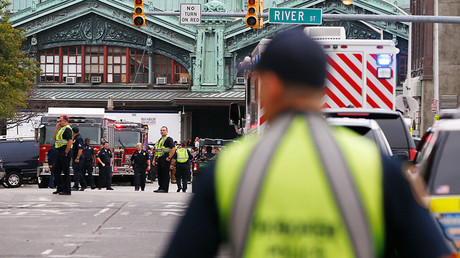 Hoboken police officers look over the scene of a train crash where a New Jersey Transit train derailed and crashed through the station, injuring more than 100 people, in Hoboken, New Jersey © Shannon Stapleton