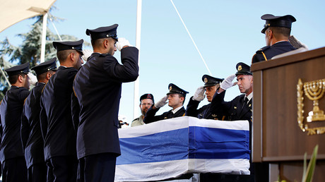 Former Israeli President Shimon Peres's casket was placed outside the Knesset (the country's parliament), so that members of the public could pay their last respects on Thursday. © Abir Sultan