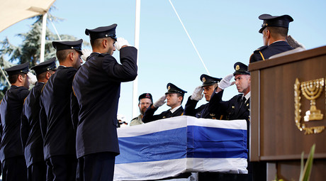 Prime Minister Benjamin Netanyahu, President Reuven Rivlin and Knesset Speaker Yuli Edelstein laid wreaths, but the public wasn't permitted to leave anything by the former leader's coffin. Peres's body was kept near the Knesset from 9am to 9pm.  © Abir Sultan