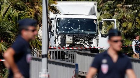 French police secure the area as the investigation continues at the scene near the heavy truck that ran into a crowd at high speed killing scores who were celebrating the Bastille Day July 14 national holiday on the Promenade des Anglais in Nice, France, July 15, 2016 © Eric Gaillard