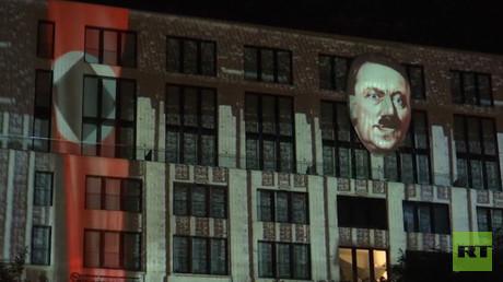 Controversial Hitler installation illuminates building in Berlin (VIDEO)