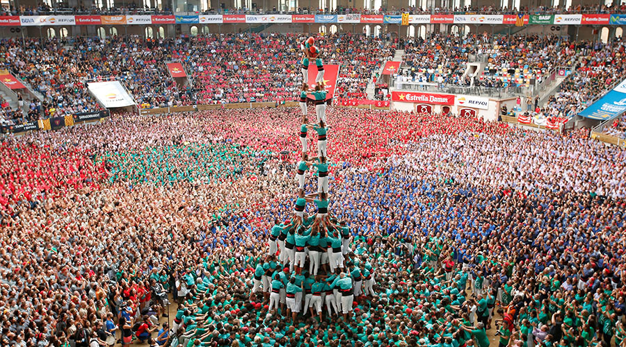 "Castellers de Vilafranca form a human tower called ""castell"" during a biannual competition in Tarragona city, Spain October 2, 2016. © Albert Gea"