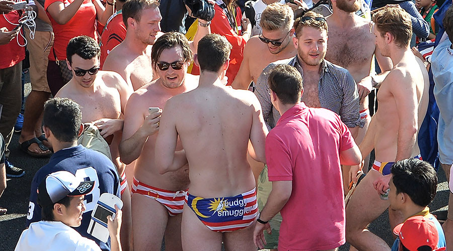 Govt adviser among Australians arrested for stripping to Speedos at Malaysian Grand Prix (VIDEOS)