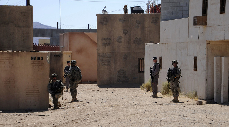 Afghan Uniform Police and soldiers from the U.S. Army 4th Brigade Combat Team provide 360-degree security outside a compound during training at National Training Center at Ft. Irwin, California, U.S. on September 18, 2011. © Austin Pritchard / U.S. Army