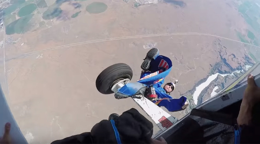 Heartstopping footage captures skydiver trailing from plane in mid-air (VIDEO)