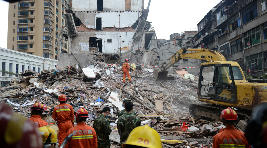 Rescue workers search at the site where residential buildings collapsed in Wenzhou, Zhejiang province, China, October 10, 2016. © Stringer