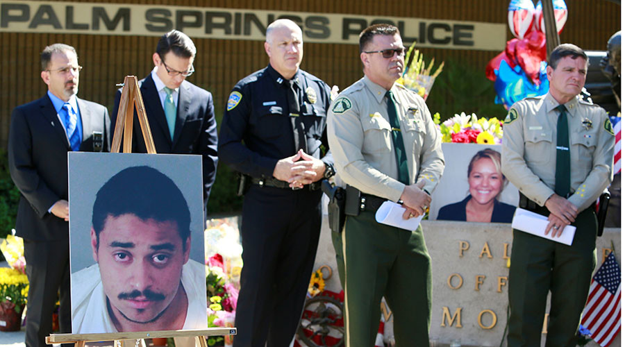A photograph of suspect John Felix is displayed at a news conference as members of the law enforcement community stand near a photo of slain Palm Springs Police officer Lesley Zerebny following the Saturday shooting deaths of Zerebny and Office Jose Vega in Palm Springs, California. October 9, 2016.
