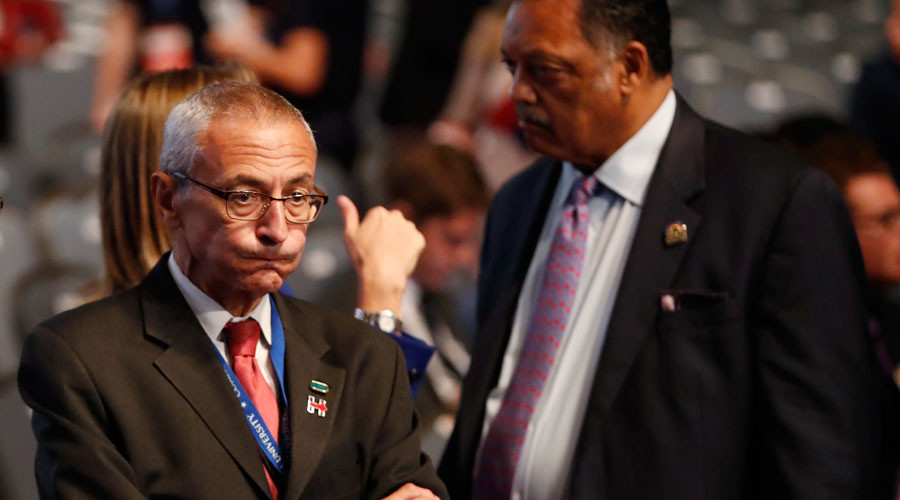 John Podesta (L), chairman of the Clinton presidential campaign, stands next to Rev. Jesse Jackson © Mike Segar