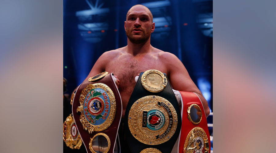 Tyson Fury voluntarily gives up world titles