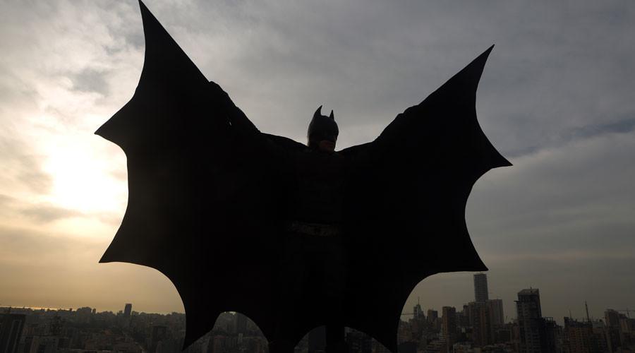 Batman to the rescue? Masked vigilante takes on Britain's 'killer clowns' (VIDEO)