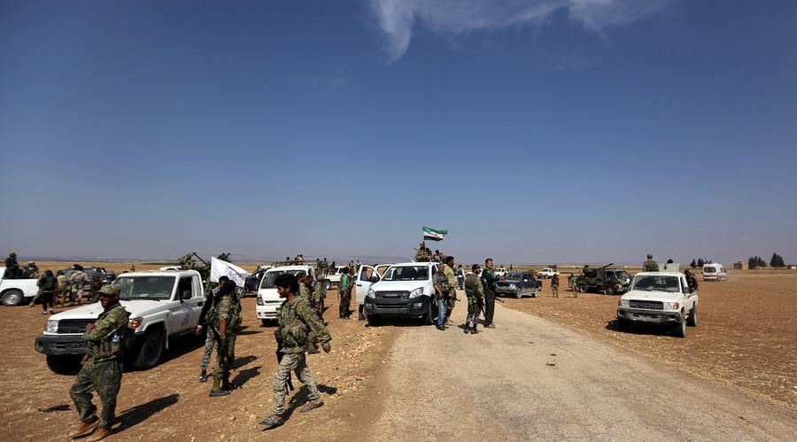 Car bomb kills at least 20 near rebel-controlled Syria-Turkey border crossing