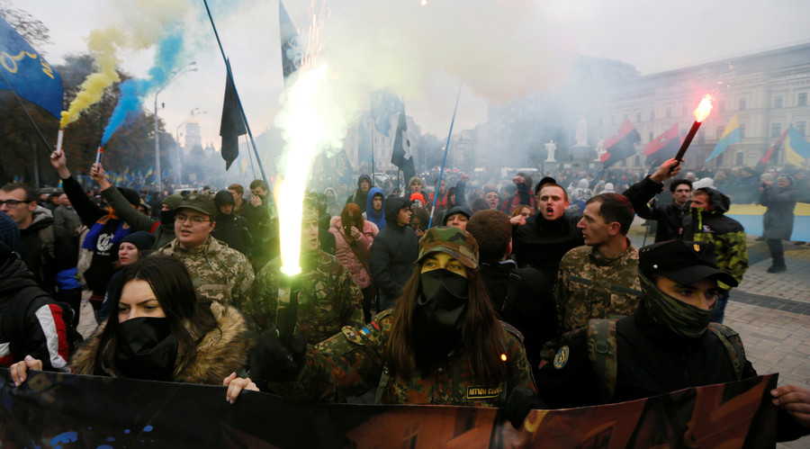 Activists shout slogans as they take part in a rally held by far-right radical groups, including All-Ukrainian Union Svoboda (Freedom), to mark Defender of Ukraine Day, in Kiev, Ukraine, October 14, 2016. © Valentyn Ogirenko
