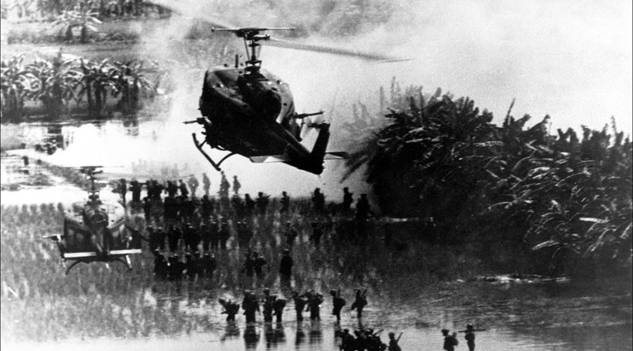 American helicopters protect infantry battalions crossing rice fields 17 August 1967 in an unlocated place during the Vietnam war ©