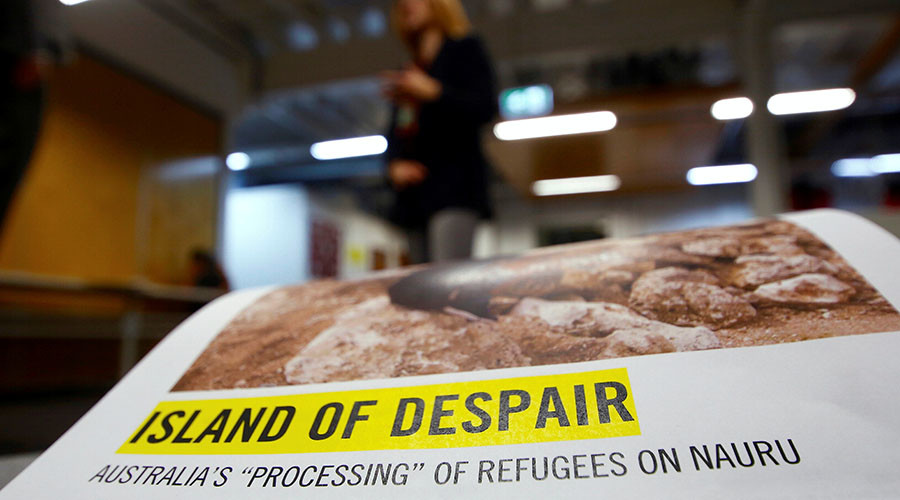 "Anna Neistat, Senior Director for Research with Amnesty International, talks to journalists behind a copy of a report she co-authored titled 'Island of Despair - Australia's ""Processing"" of Refugees on Nauru' in Sydney, Australia, October 17, 2016. © David Gray"