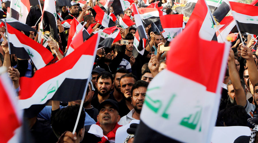 Supporters of Iraqi Shi'ite cleric Moqtada al-Sadr shout slogans during an anti-Turkey protest in front of the Turkish embassy in Baghdad, Iraq October 18, 2016. © Wissm al-Okili