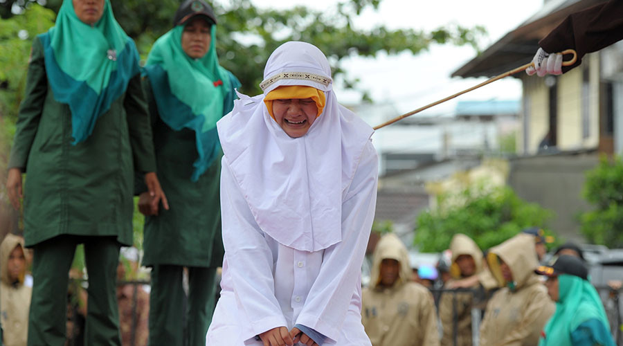 Indonesian woman flogged for standing too close to boyfriend (PHOTOS)