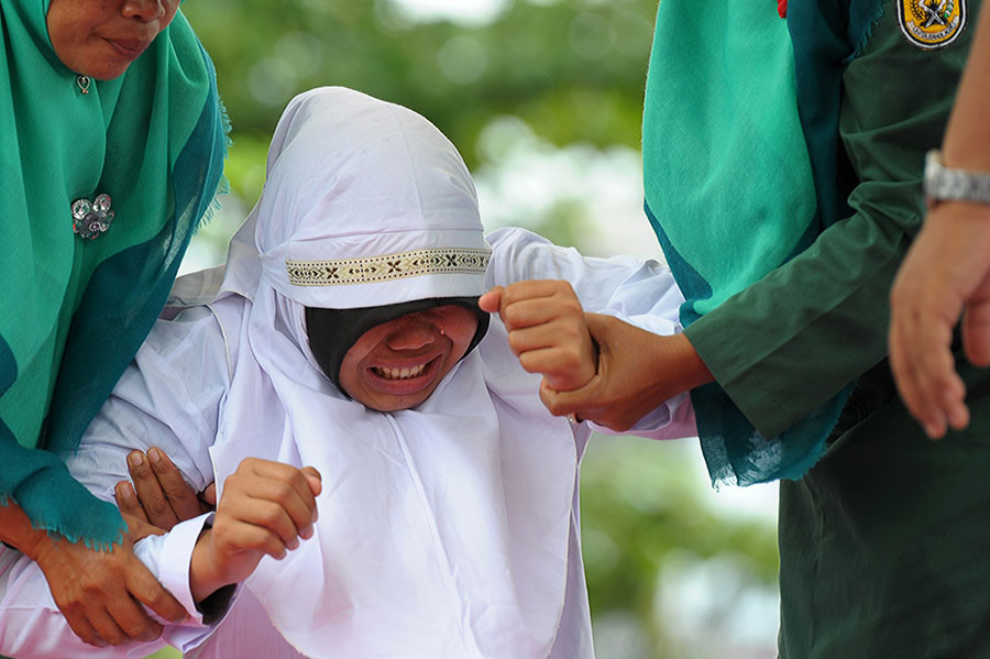 A Muslim woman about  to be caned 23 in Banda Aceh. ©Chaideer Mahyuddin