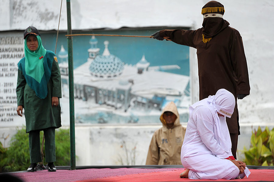 A Muslim woman just before being caned in Aceh. © Chaideer Mahyuddin