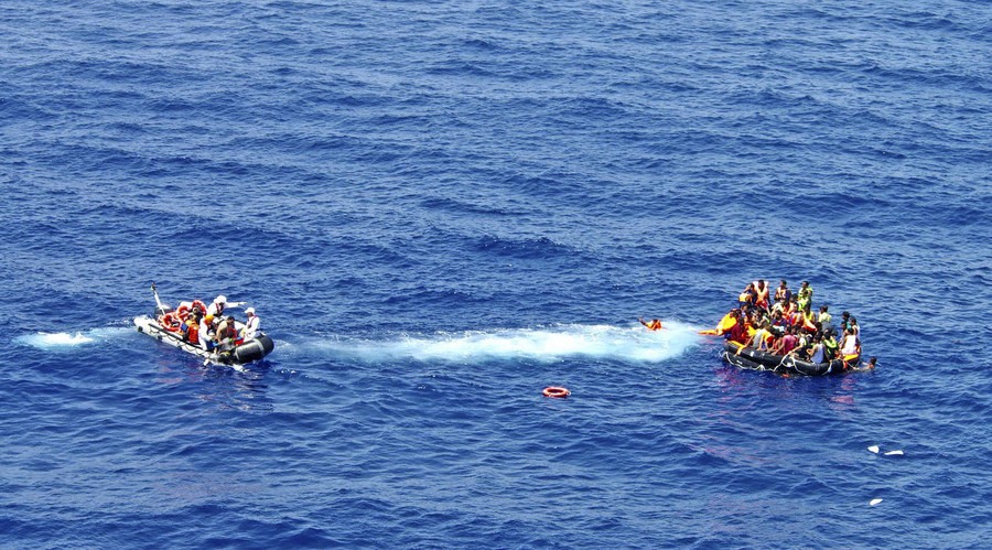 Surviving migrants are seen aboard a life-rafts in the area where their wooden boat capsized and sank off the coast of Libya in this August 5, 2015. © Italian Navy/ Handout via Reuters