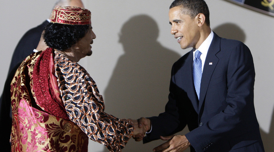 U.S. President Barack Obama shakes hands with Libya's leader Muammar Gaddafi before a dinner at the G8 summit in L'Aquila, Italy, July 9, 2009. © Stefano Rellandini